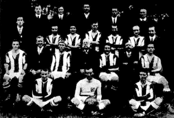 Reading left to right. — Front Row: *J. W. Masters, E. Mobbs, *W. E. S. Dane. Second Row: *H. Wheat, J. Kiordan (chairman G. and D.F.A.), R.H. Moore (captain), T. Nobbs (patron), H. Hoffman, J. Tillman, L. Gill. Third Row: A. Epps (hon. sec. G. and D.F.A.), *R. Fairweather, J. W. Cottam, F. M. Smith, J. Davis, E. J. Doherty, F. Robertson (hon. sec). Back Row: F. Waddell (manager), A. Peaty, S. Hilder, *Sergeant-major F. Doherty, P. T. Williams. Asterisk denotes those at the front.